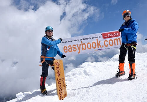 Easybook flag on the summit of Haba Snow Mountain (5396m)